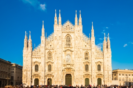 ful: Milan Cathedral  Duomo di Milano  is the gothic cathedral church of Milan, Italy  Shot in the dusk from the square ful of people  Stock Photo