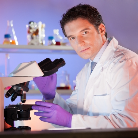 dental research: Portrait of a confident male health care professional in his working environment.