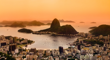 loaves: Rio de Janeiro, Brazil. Suggar Loaf and  Botafogo beach viewed from Corcovado at sunset.