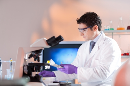 dental research: Portrait of a  male health care professional in his working environment. Stock Photo