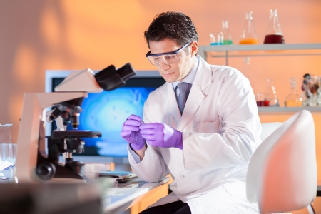 research worker: Portrait of a  male health care professional in his working environment. Stock Photo