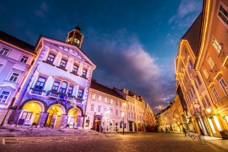 Romantic Ljubljanas city center, the capital of Slovenia, decorated for Christmas holidays. City Hall shot at dusk. photo