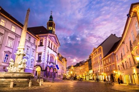 ljubljana: Romantic Ljubljanas city center, the capital of Slovenia, Europe. City hall and Robas fountain shot at dusk. Stock Photo