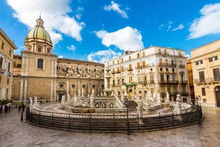 In the heart of Palermos loveliest square, Piazza Pretoria, stands this magnificent fountain, Fontana Pretoria, work of the Florentine sculptor Francesco Camilliani. Palermo, Sicily, Italy.