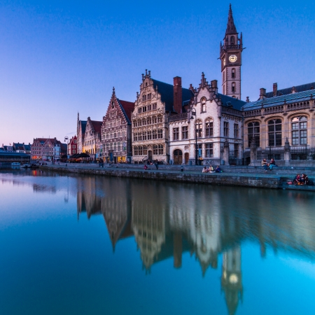 Picturesque medieval buildings overlooking the Graslei harbor on Leie river in Ghent town, Belgium, Europe. Editorial