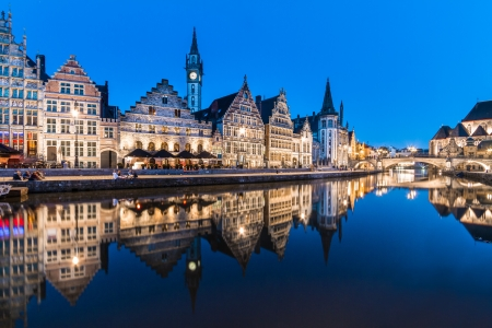 Picturesque medieval buildings overlooking the Graslei harbor on Leie river in Ghent town, Belgium, Europe.
