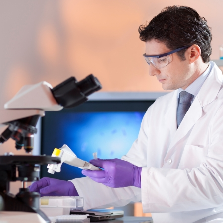 dental research: Portrait of a  male health care professional in his working environment