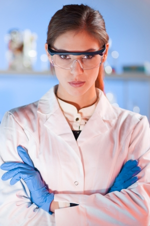 dental research: Portrait of a confident female health care professional in her working environment
