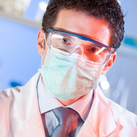 male dentist: Portrait of a confident male health care professional in his working environment