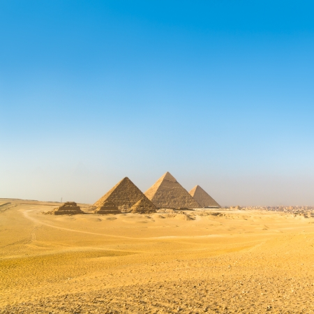 largely: The pyramids of Giza, Cairo, Egypt;  the oldest of the Seven Wonders of the Ancient World, and the only one to remain largely intact Stock Photo