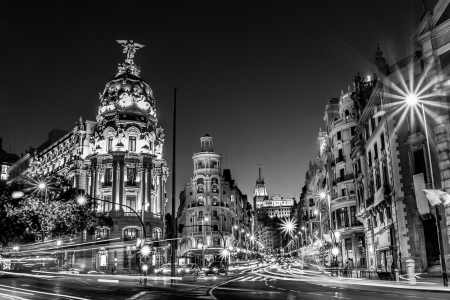 black and white: Rays of traffic lights on Gran via street, main shopping street in Madrid at night  Spain, Europe