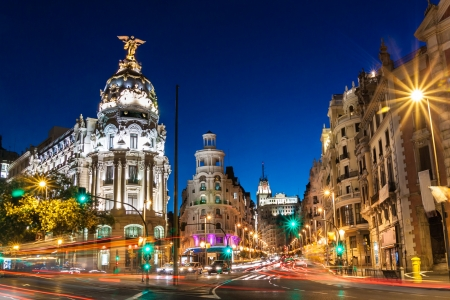 Rays of traffic lights on Gran via street, main shopping street in Madrid at night. Spain, Europe. photo