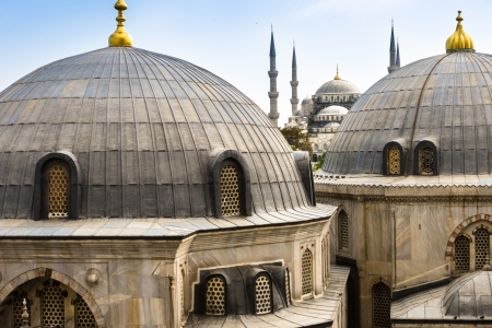 Blue Mosque or Sultan Ahmed Mosque viewed trough the window of Hagia Sophia, former Orthodox patriarchal basilica  church , later a mosque, and now a museum in Istanbul, Turkey
