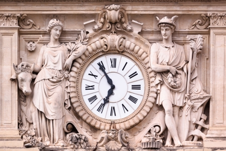 architectural heritage: Antic ornate clock on one of the medieval hose facades in Montpellier, south France, Europe Stock Photo