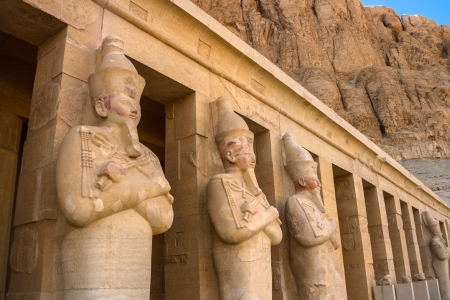 obelisk stone: A row of statues of Queen Hatshepsut as Osiris, the god of the dead, at her temple in Luxor  Thebes , Egypt