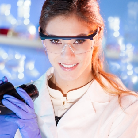 dental research: Portrait of a attractive, young, confident female health care professional in hes working environment. Stock Photo
