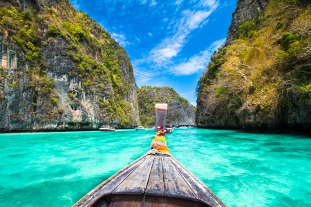 adventure holiday: Traditional wooden  boat in a picture perfect tropical bay on Koh Phi Phi Island, Thailand, Asia  Stock Photo