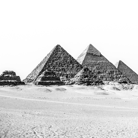 intact: The pyramids of Giza, Cairo, Egypt;  the oldest of the Seven Wonders of the Ancient World, and the only one to remain largely intact  Black and white  Stock Photo