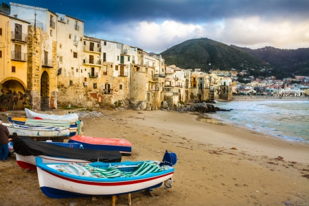 mediterranean houses: Old, medieval Cefalu is a city and comune in the Province of Palermo, located on the northern coast of Sicily, Italy on the Tyrrhenian Sea. The town is one of the major tourist attractions in the region. Shot after summer storm.