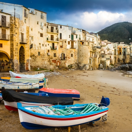fishing village: Old, medieval Cefalu is a city and comune in the Province of Palermo, located on the northern coast of Sicily, Italy on the Tyrrhenian Sea. The town is one of the major tourist attractions in the region. Shot after summer storm.