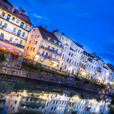 Romantic medieval Ljubljanas city center, the capital of Slovenia, Europe. Gallus bank of river Ljubljanica shot at dusk. photo