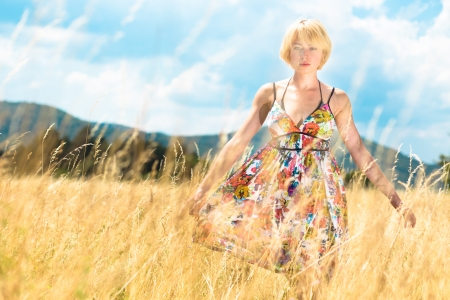 Lady enjoying the nature. Young woman enjoying the fresh air in summer meadow. photo