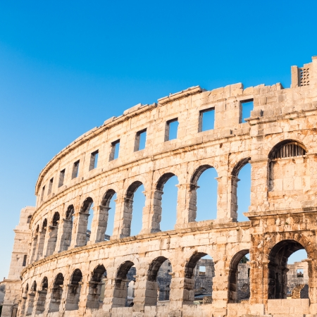 arenas: The Roman Amphitheater of Pula, Croatia shot at dusk  It was constructed in 27 - 68 AD and is among the six largest surviving Roman arenas in the World and best preserved ancient monument in Croatia