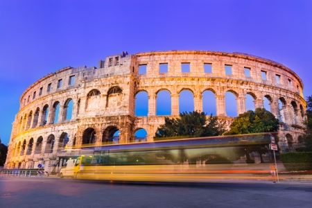 best ad: The Roman Amphitheater of Pula, Croatia shot at dusk  It was constructed in 27 - 68 AD and is among the six largest surviving Roman arenas in the World and best preserved ancient monument in Croatia