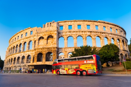The Roman Amphitheater of Pula, Croatia shot at dusk  It was constructed in 27 - 68 AD and is among the six largest surviving Roman arenas in the World and best preserved ancient monument in Croatia