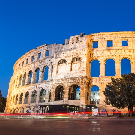 roman empire: The Roman Amphitheater of Pula, Croatia shot at dusk  It was constructed in 27 - 68 AD and is among the six largest surviving Roman arenas in the World and best preserved ancient monument in Croatia