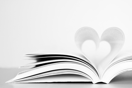 media love: Pages of a book forming the shape of the heart.