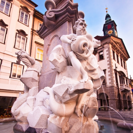 zeus: Evening view of Ljubljanas historic city center, Robas fountain and the town hall in the background. Stock Photo