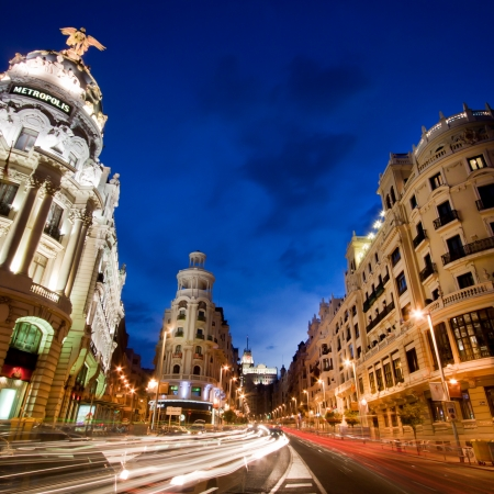 gran via: Rays of traffic lights on Gran via street, main shopping street in Madrid at night. Spain.