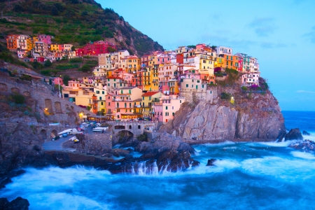 mediterranean houses: Manarola fisherman village in a dramatic wind storm. Manarola is one of five famous villages of Cinque Terre (Nationa park), suspended between sea and land on sheer cliffs upon the wild waves. Stock Photo