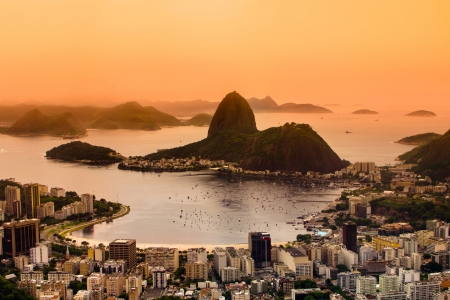 brazil: Rio de Janeiro, Brazil. Suggar Loaf and  Botafogo beach viewed from Corcovado at sunset.