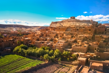 fortified: Ait Benhaddou is a fortified city, or ksar, along the former caravan route between the Sahara and Marrakech in present day Morocco. It is situated in Souss Massa Draa on a hill along the Ounila River and is known for its kasbah.