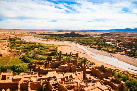 arabic desert: Ait Benhaddou is a fortified city, or ksar, along the former caravan route between the Sahara and Marrakech in present day Morocco. Situated in Souss Massa Draa on a hill along the Ounila River and is known for its kasbah.
