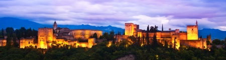Evening panoramic view of Spain's main tourist attraction: ancient arabic fortress of Alhambra, Granada, Spain.