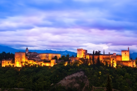 Evening panoramic view of Spains main tourist attraction: ancient arabic fortress  of Alhambra, Granada, Spain.