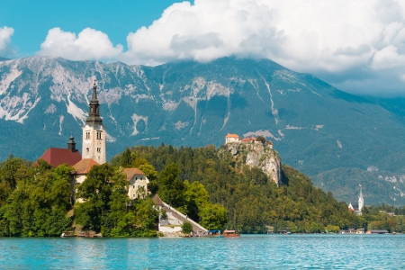 bled: Panoramic view of  Lake Bled with St. Marys Church of the Assumption on the small island; Bled, Slovenia, Europe.