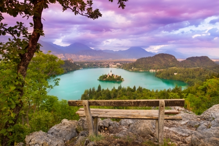 slovenia: Sunset panoramic view of  Julian Alps, Lake Bled with St. Marys Church of the Assumption on the small island; Bled, Slovenia, Europe.