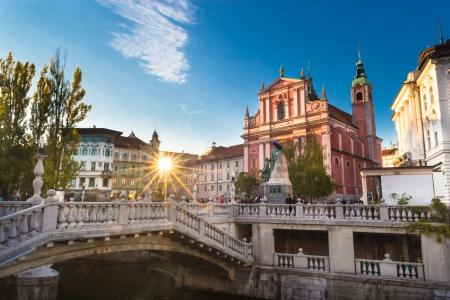 triple: Romantic Ljubljanas city center:  river Ljubljanica, Triple Bridge (Tromostovje), Preseren square and Franciscan Church of the Annunciation; Ljubljana, Slovenia, Europe.