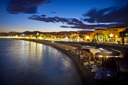 french riviera: The beach and the waterfront of Nice at night, France. Stock Photo