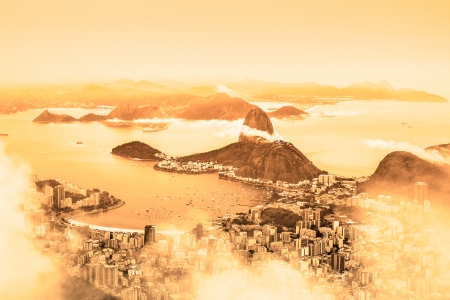 Rio de Janeiro, Brazil. Suggar Loaf and  Botafogo beach viewed from Corcovado at sunrise. photo