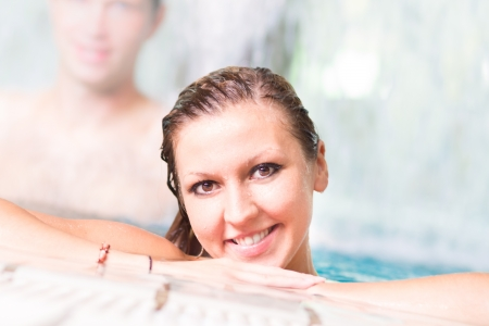 Young couple relaxing in the indoor swimming pool. photo