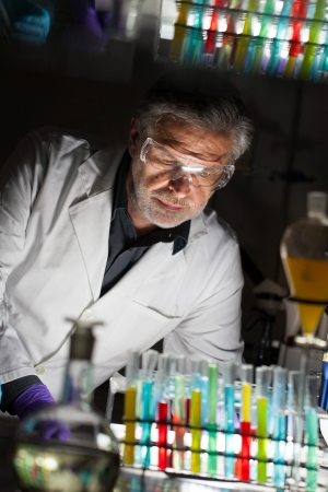 analytical chemistry: Senior male chemist working late hours in science research laboratory  chemistry, analytical, organic, structural, biochemistry, genetics, forensics, microbiology    Stock Photo