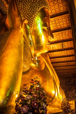 Reclining golden buddha in wat Pho temple, Bangkok, Thailand