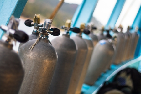 compressed: Row of oxigen tanks for scuba diving. Stock Photo