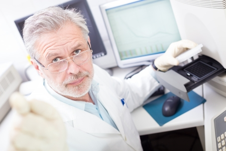 personalized: Life science researcher  performing a genotyping testing which enables personalized medicine. PM is a medical model that proposes the customization of healthcare.