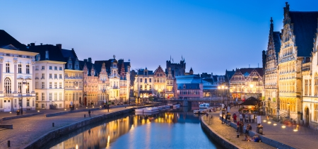 Picturesque medieval buildings overlooking the Graslei harbor on Leie river in Ghent town, Belgium, Europe. photo